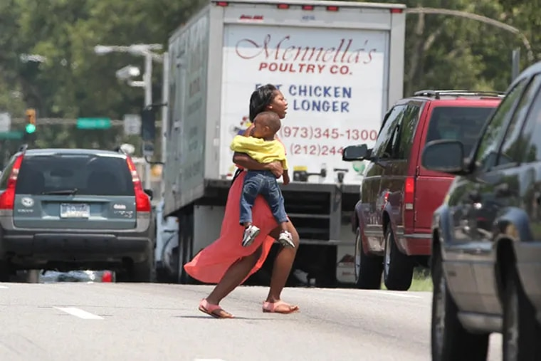 A woman runs through traffic across Roosevelt Boulevard. In Philadelphia's stepped-up efforts to reduce pedestrian deaths and injuries, one tactic has not been used: Issuing tickets to scofflaw pedestrians.