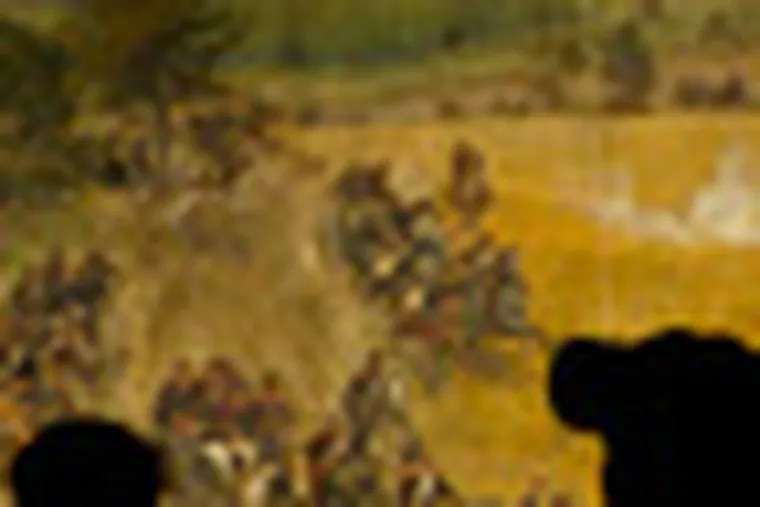 """PARKS21A 7/20/04 PHOTO BY ERIC MENCHER. In this photo, Carl Patrick Scheid (left) and his brother John Scheid, both of Bethesda, Md., look at the Cyclorama painting """"The Battle of Gettysburg"""" by Paul Philippoteaux (painted in 1883-1884) at the Gettysburg National Military Park in Gettysburg, Pa.. Above them is a hole in the ceiling caused by a faulty roof and poor design. Accompanies a story by Paul Nussbaum on the state of the national parks."""