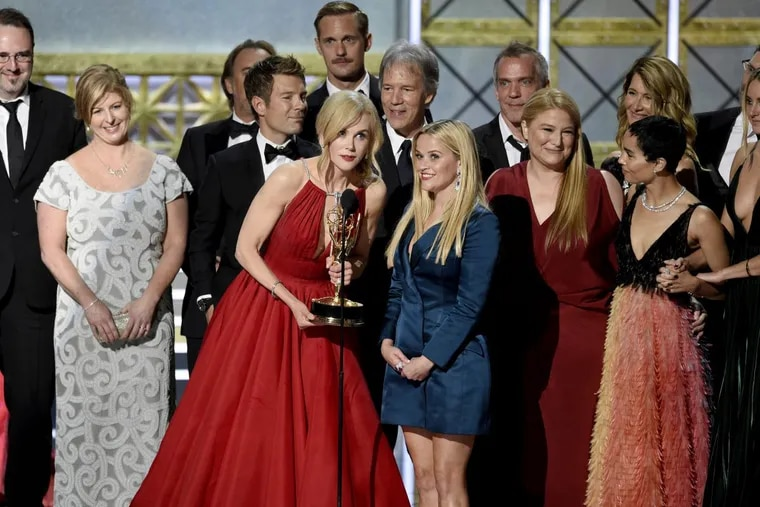 """Nicole Kidman, center left, Reese Witherspoon, center right, and cast and crew accept the award for outstanding limited series for """"Big Little Lies"""" at the 69th Primetime Emmy Awards."""