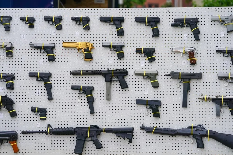 A display of guns on a board at a press conference at the Philadelphia Police Department Office of Forensic Science in May.