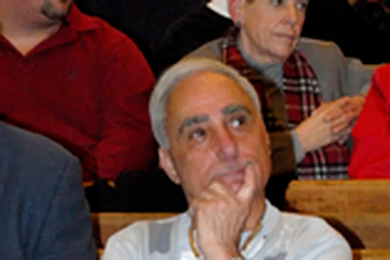 Joey Vento , owner of Geno's, listens to the proceedings at the Arch Street Friends Meeting House.
