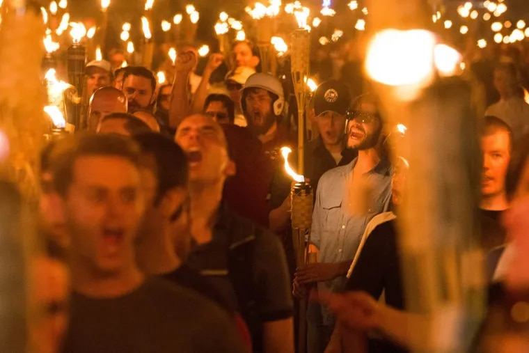 """Neo-Nazis, white nationalists and white supremacists march through the University of Virginia the night before the Aug. 11 """"Unite the Right"""" rally."""