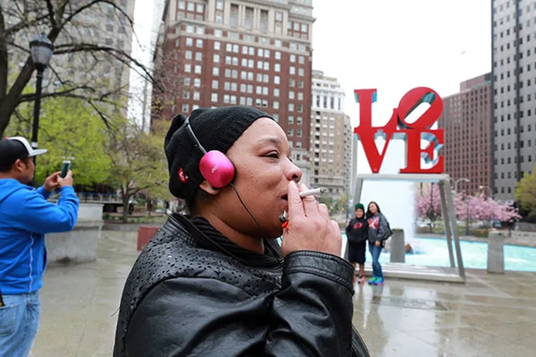 Darlene Scott takes a drag from her cigarette in LOVE park Tuesday April 29, 2014. ( DAVID SWANSON / Staff Photographer )