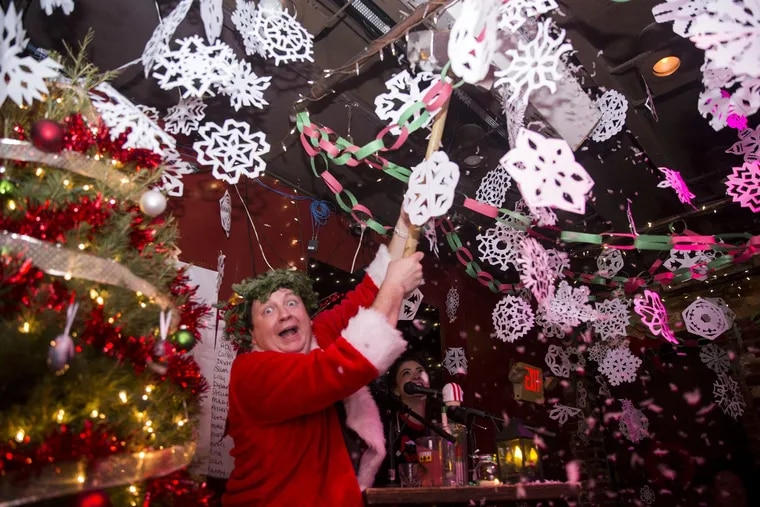 Joe Gunn, co-owner of Jose Pistola's, stands amid a sea of thousands of paper snowflakes, an annual part of the Jose Pistola's Christmas Smackdown Bar Crawl.