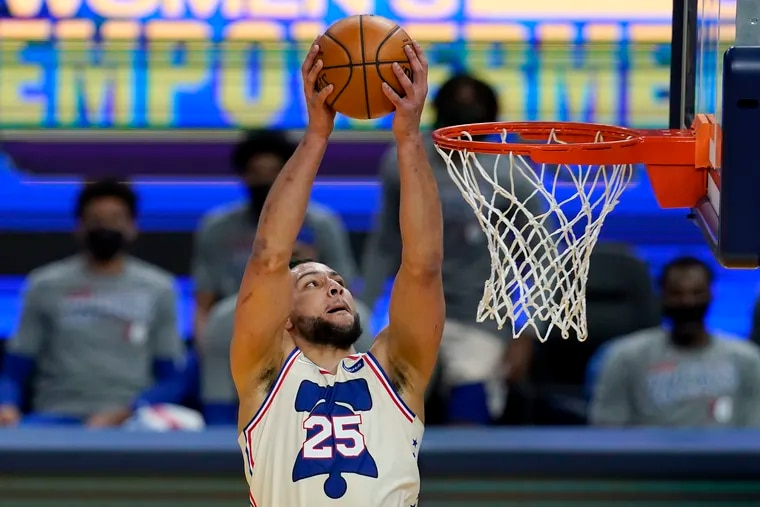 Ben Simmons dunks against the Golden State Warriors during the first half Tuesday.