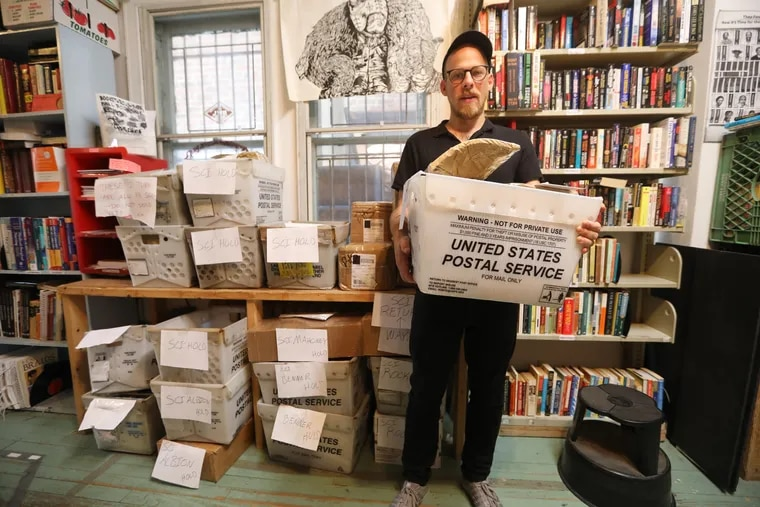 Keir Neuringer and the bins of unmailed packages of books that were supposed to go out to Pennsylvania prison inmates but were held back because of a lockdown.