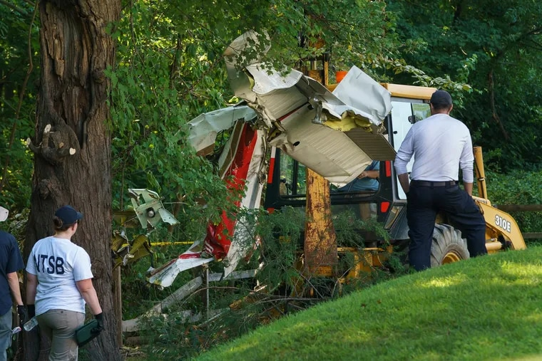 NTSB investigators removing wreckage of a single-engine plane that crashed in a residential neighborhood in Upper Moreland, killing two Philadelphia doctors and their 19-year-old daughter.