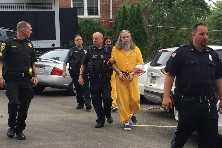 Lee Kaplan, front in yellow, is led to a preliminary hearing Aug. 2, 2016, in Bucks County. (MEGAN TRIMBLE / Associated Press)