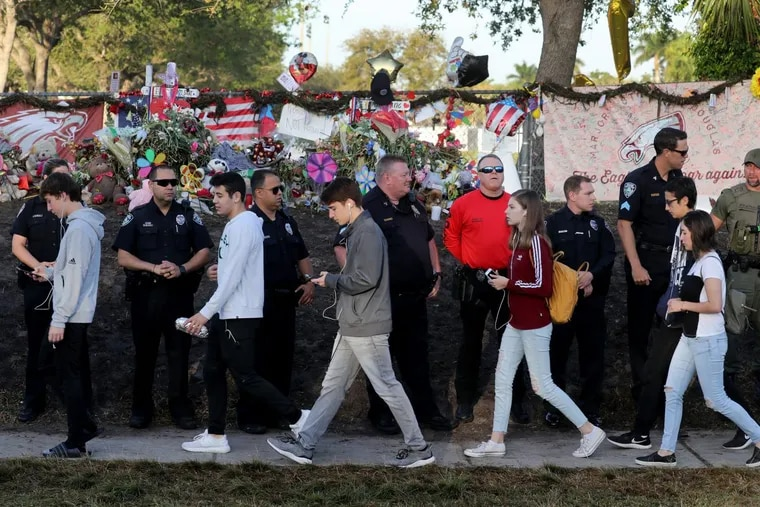 Students head back to school at Marjory Stoneman Douglas High School for the first time after a gunman killed 17 students in the school on Valentine's Day on Wednesday, Feb. 28, 2018 in Parkland, Fla.
