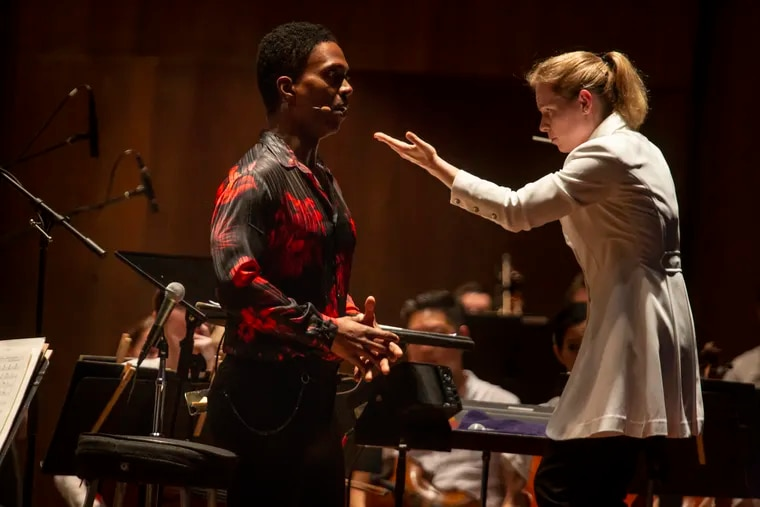 """New Zealand conductor Gemma New leads the Philadelphia Orchestra in a space-themed program at the Mann Center on July 24, 2019. Baritone Nmon Ford sang """"Moon River"""" and a Wagner selection."""
