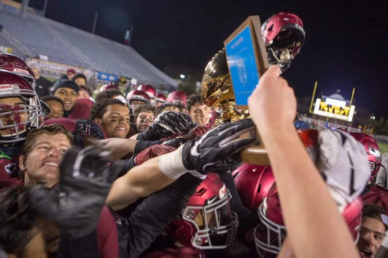 St. Joseph players hold up the trophy high after winning the PIAA Class 6A Football Championship in Hershey, Pa., Sat. Dec. 8, 2018. For the Inquirer/Kalim A. Bhatti