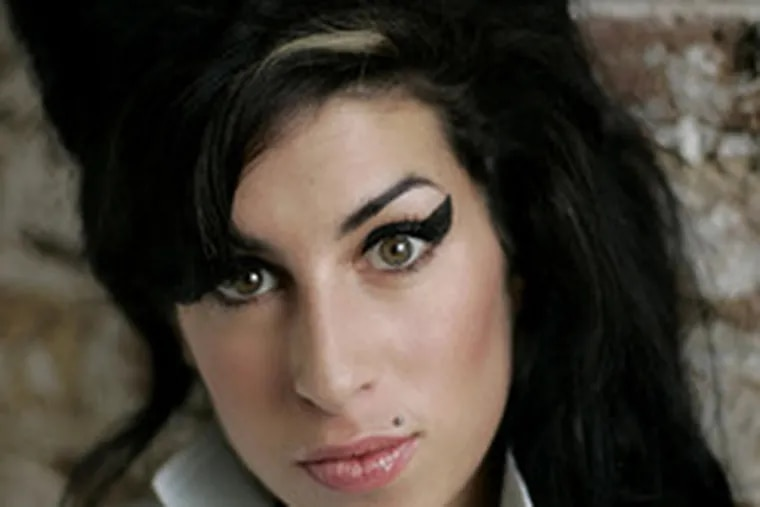 """Amy Winehouse: Addicted, malnourished, and Lagerfeld's """"style icon."""""""