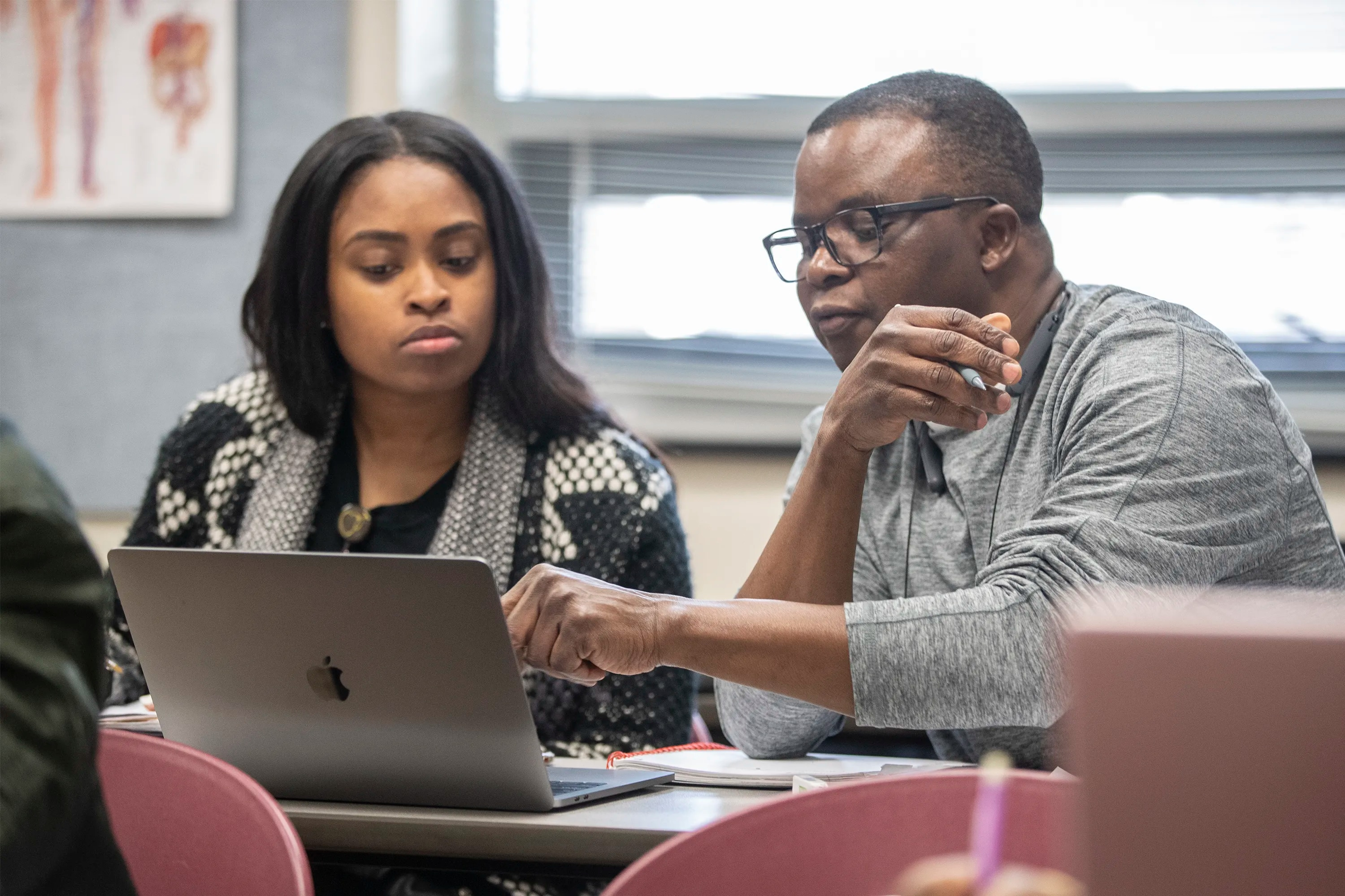 Level 1 nursing students, Kiara Boyd, left, and Olu Atilade, right, work together to complete their class assignment at the one-year nursing school at Eastern Center for Arts and Technology on January 16, 2020.