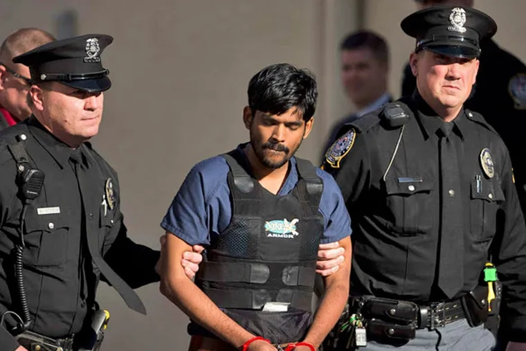 Raghunandan Yandamuri , whose trial has been delayed in the October 2012 double homicide, lived in the same apartment complex where the victims were found. MATT ROURKE / AP
