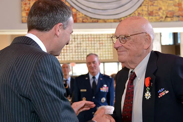 Kurt Deardorf (right) is presented with France's highest military medal, the Legion of Honour, by Olivier Sérot-Alméras, French consul general at the French Embassy in Washington, D.C. on March 26, 2014.  ( Photo via The Embassy of France )