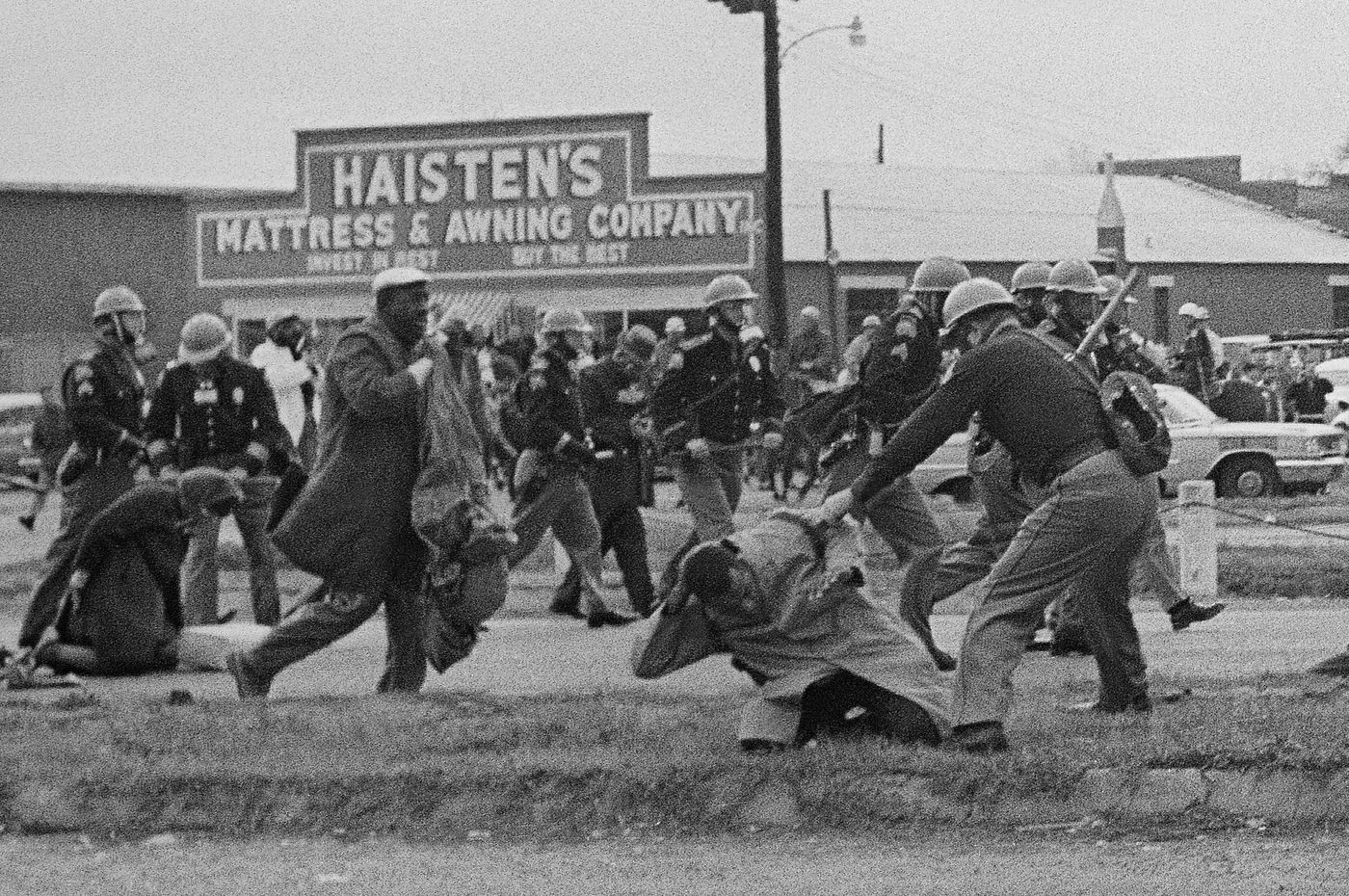 State troopers use billy clubs against civil rights marchers, including John Lewis (foreground) in Selma, Ala., on March 7, 1965.