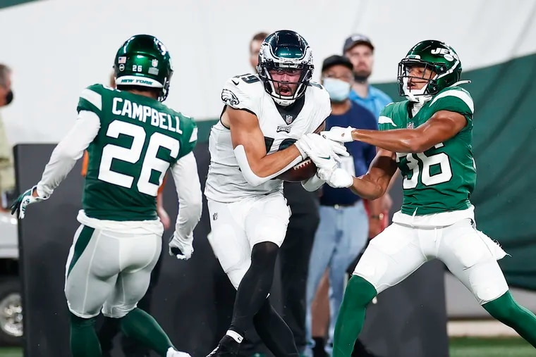 Eagles wide receiver J.J. Arcega-Whiteside catches the football against New York Jets cornerback Isaiah Dunn (right) and defensive back Elijah Campbell in the second quarter in a preseason game on Friday, August 27, 2021 in East Rutherford, N.J.  Arcega-Whiteside scored a touchdown on the play.