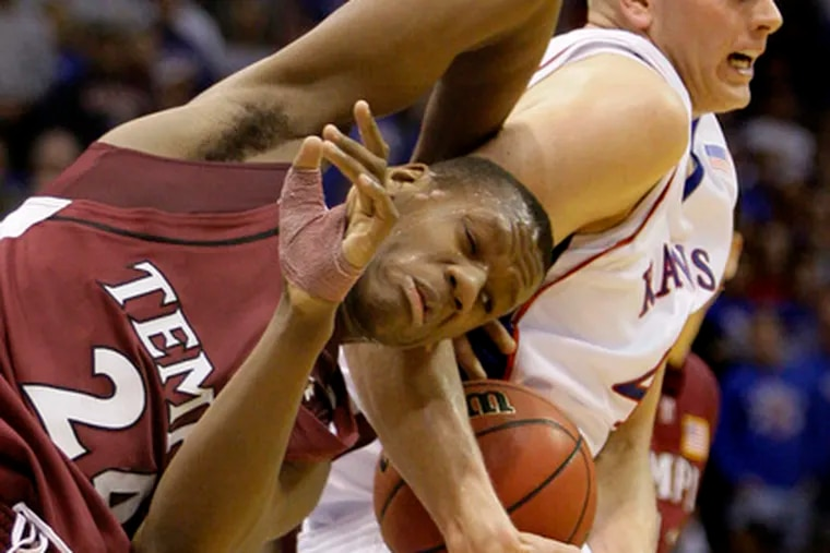 Tangled up in cherry and blue: Temple's Lavoy Allen and Cole Aldrich of Kansas vie for the ball. Allen finished with 7 boards.