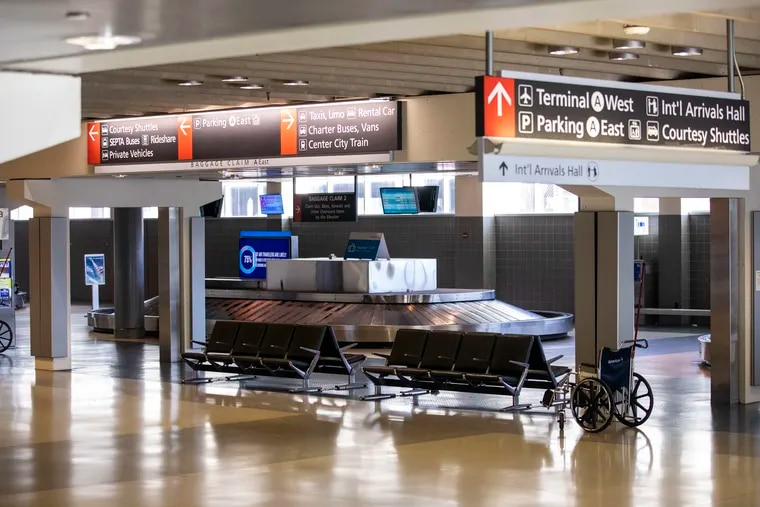 The empty baggage claim area at the Philadelphia International Airport in Philadelphia, Pa. on Monday, March 16, 2020.  Dozens of presumed positive cases of the coronavirus have been reported in Pennsylvania and New Jersey, with the case count escalating daily.
