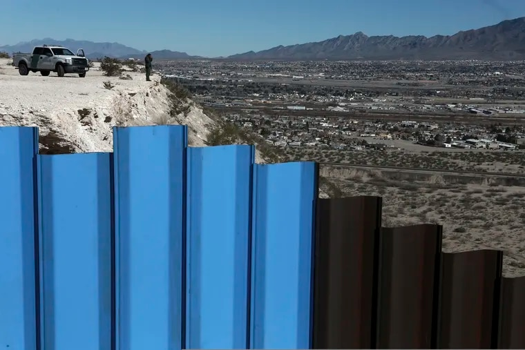 FILE - In this Jan. 25, 2017, file photo, an agent from the border patrol, observes near the Mexico-US border fence, on the Mexican side, separating the towns of Anapra, Mexico and Sunland Park, N.M. An 8-year-old boy from Guatemala died in government custody early Tuesday, Dec. 25, 2018, U.S. immigration authorities said.