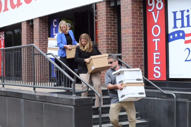 FBI employees carry out boxes from the Spring Garden Street offices of the International Brotherhood of Electrical Workers Local 98 in Philadelphia on Aug. 5, 2016. The first criminal charges in the investigation were revealed Monday with a guilty plea from a New Jersey electrical contractor with longstanding ties to both the union and its leader, John J. Dougherty.