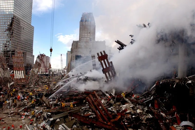 Fires still burn amidst the rubble of the World Trade Center on September 13, 2001 days after the September 11, 2001 terrorist attack.