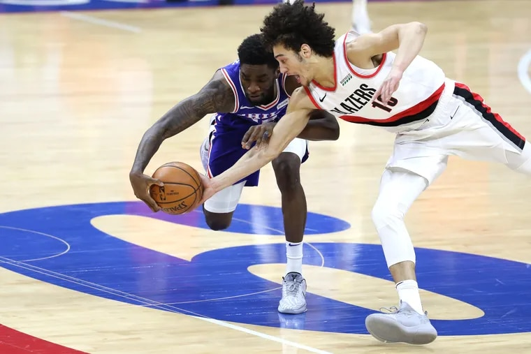 Shake Milton, left, of the SIxers has the ball stolen by CJ Elleby of the Trailblazers during the 2nd  half of a NBA game at the Wells Fargo Center on Feb. 4, 2021.