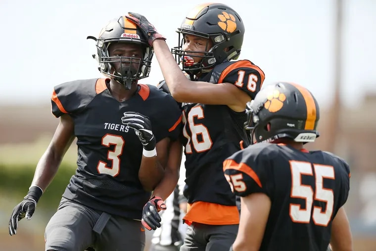 Woodrow Wilson's Malik Harvey (3), shown earlier this season with teammates Jazmere Hopps (16) and Ronald Torres (55), was a big-play man on both sides of the football during the Tigers' 12-7 win over Wall Twp. in the South/Central Group 3 regional championship game.