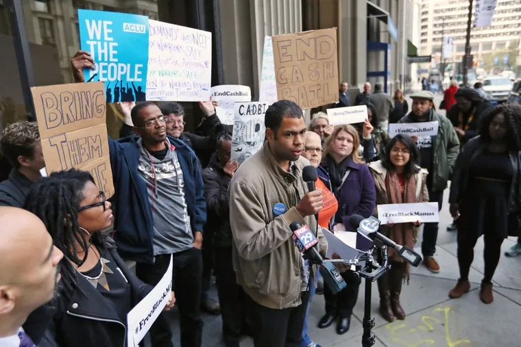 Rick Krajewski, an organizer with Reclaim Philadelphia and a member of the coalition, speaks at a rally outside the District Attorney's Office on Thursday Nov. 9, 2017.