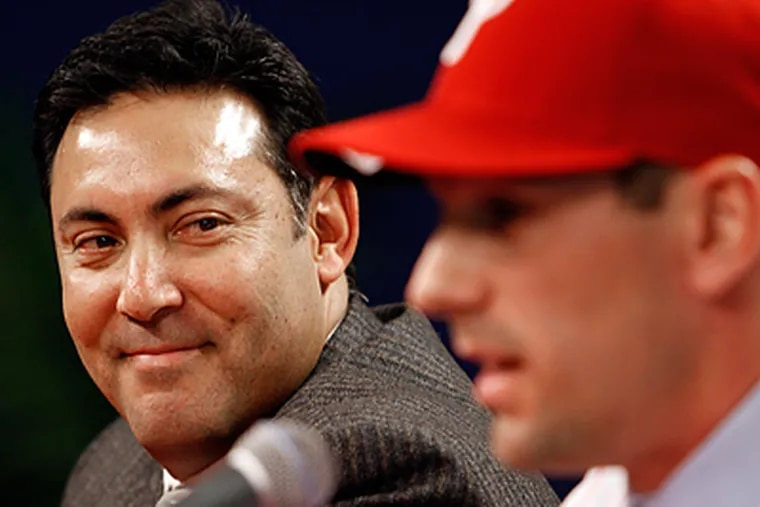 Phillies GM Ruben Amaro Jr. and Cliff Lee speak with the media during a press conference Wednesday. (Laurence Kesterson / Staff Photographer)