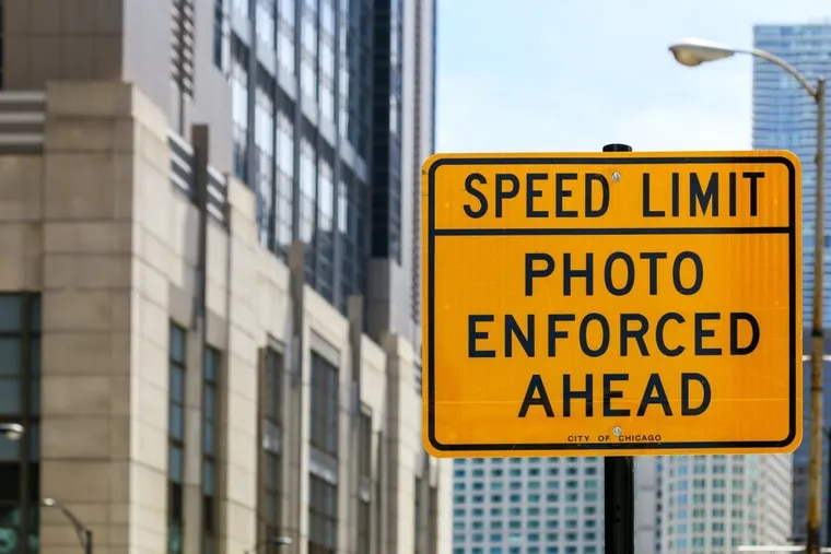 A sign marks an area where the speed limit is enforced by camera in Chicago.