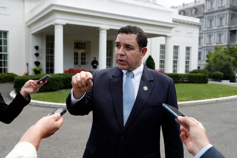 FILE - In this Sept. 13, 2017, file photo, Rep. Henry Cuellar (D., Texas) speaks with reporters outside the West Wing after a bipartisan meeting with President Donald Trump at the White House, in Washington. Kristie Small, a former senior aide to Cuellar, filed a lawsuit against the Texas Democrat in Washington on Monday that claims she was wrongly fired for being pregnant. The lawsuit argues Cuellar's firing of Small was both sex and pregnancy discrimination in violation of the Congressional Accountability Act of 1995.