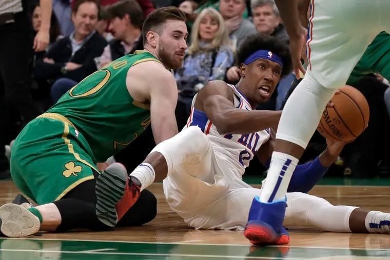 76ers guard Josh Richardson controls the ball during a floor scramble against Celtics forward Gordon Hayward, left.