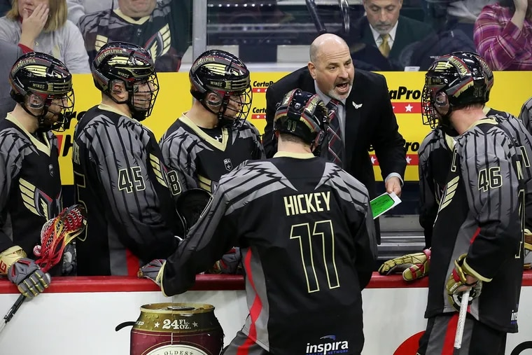 Wings coach Paul Day talks with his players during the Wings' inaugural game since returning to Philadelphia.