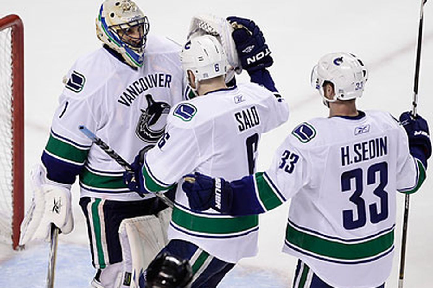 Canucks win, push Sharks to brink
