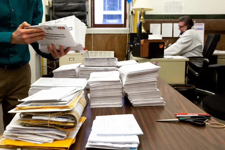In a file photo, a worker counts Philadelphia absentee ballots that arrived after the deadline to be counted in the November 2018 midterm election.