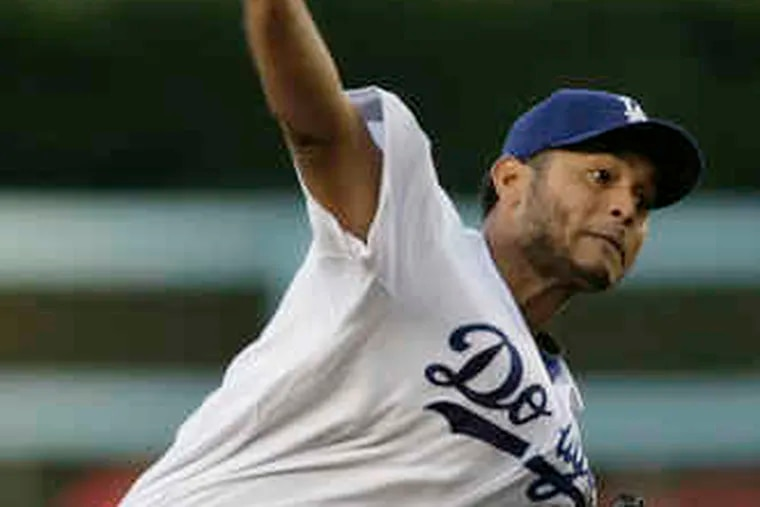 Carlos Monasterios got the win for pitching six innings Monday as the Dodgers beat the Cardinals, 12-4.