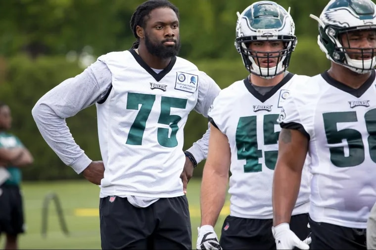 Josh Sweat (left) at the Eagles rookie camp at the Novacare Complex on Friday.