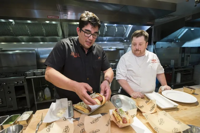 Jose Garces (left) and Gregg Ciprioni, his vice president of culinary operations, work in the test kitchen at 2401 Walnut St. on April 25, 2018.