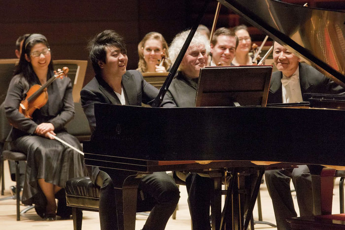 Pianist Lang Lang's antics tempered and abetted by conductor Simon Rattle