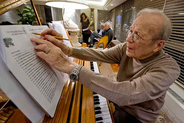 Harry Gartzman, 93, makes a notation on a song during a practice session Dec. 6, 2012 for the upcoming Christmas carols singalong at The Philadelphia condo complex on Dec. 19.  Gartzman recovered from a stroke thanks to his love of music and playing the piano.  ( CLEM MURRAY / Staff Photographer )
