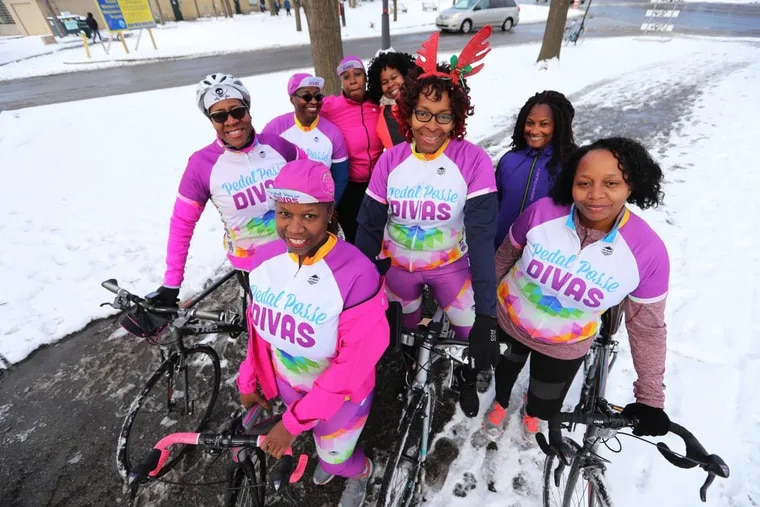 Pedal Posse Divas Stephanie Ford (front and then clockwise), Rosa Pujols, Frann Mawusi, Sonja West, Richonda Preston, Katrese Collier, Wendy Waddell, Betty Ann Givens (center) gather at Lloyd Hall.