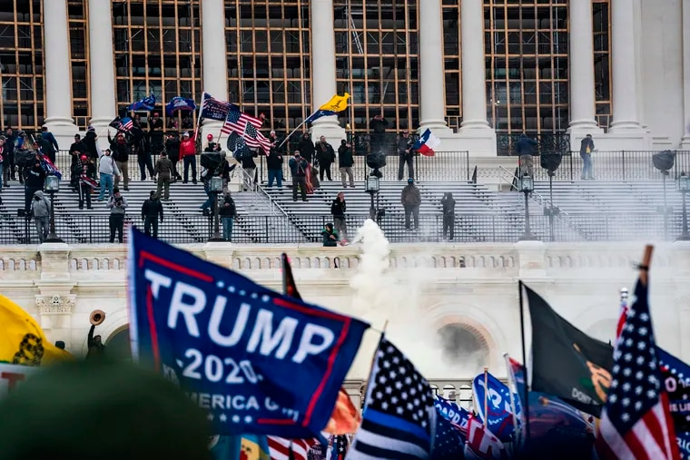 Supporters of US President Donald Trump clash with the Capitol police during a riot at the U.S. Capitol on Jan. 6, 2021, in Washington, DC.