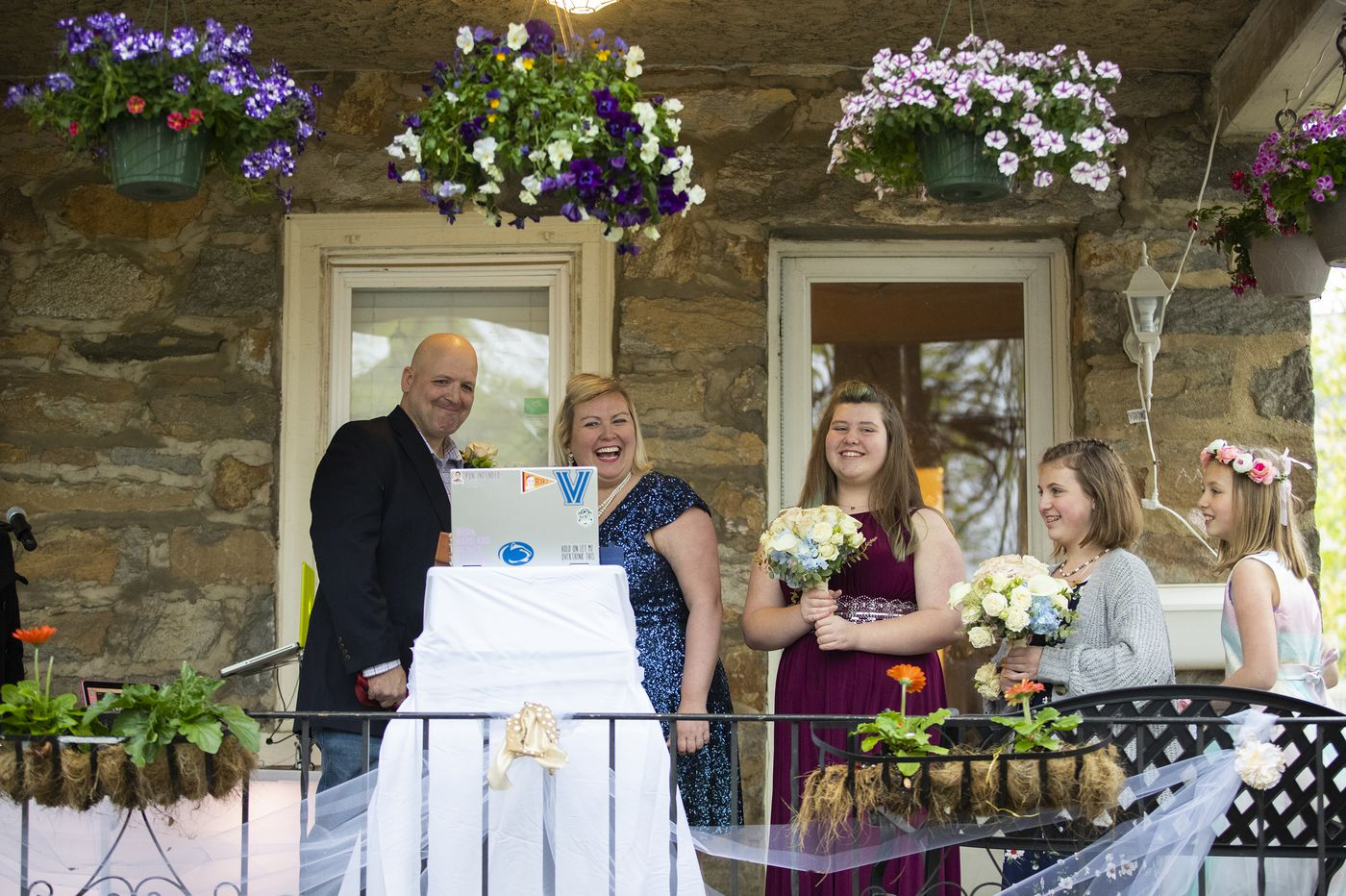 With neighbors in driveways and friends and family on Facebook, this Delco couple elope on their front porch