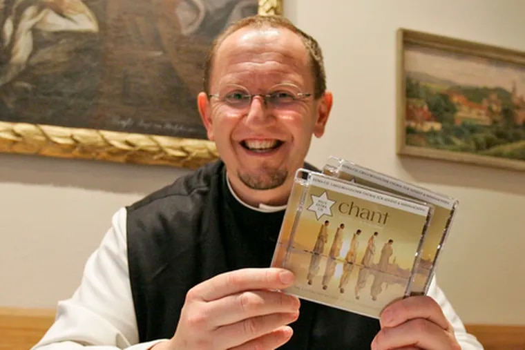 """Father Karl Wallner holds copies of the """"Chant"""" music CD. """"I get the sense this music is able to fill a vacuum within a lot of people,"""" he said."""