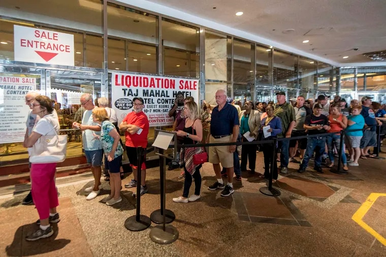 Buyers line up outside the former Trump Taj Mahal Hotel and Casino in Atlantic City for a liquidation sale in 2017.
