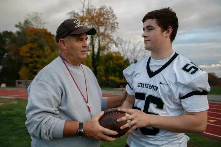 Strath Haven football coach Kevin Clancy. here with player Ryan Morris, has 300 career victories.