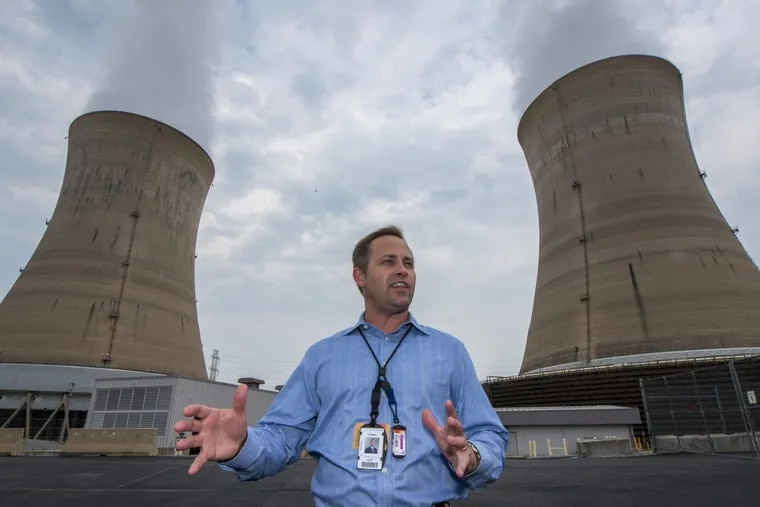 Thomas P. Haaf,  manager of Exelon's Three Mile Island Unit 1, stands in front of the nuclear plant's iconic cooling towers near Middletown, Pa.