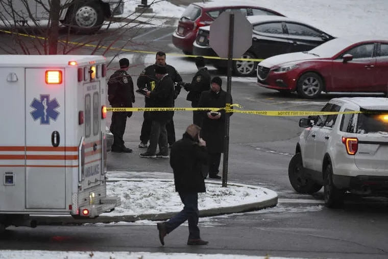 Authorities investigate the scene of a shooting at the Pennsylvania State University campus in Beaver County in Monaca, Pa., Wednesday, Dec. 13, 2017.