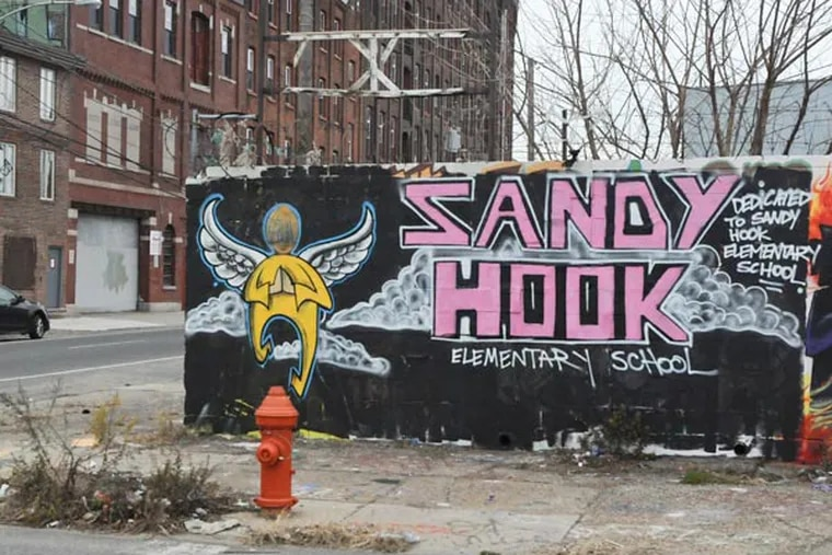 """A """"pop-up"""" mural on North 5th Street and Cecil B. Moore honoring victims of Sandy Hook shootings. December 24, 2012 ( RON TARVER / Staff Photographer )"""